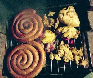 Chicken and sausages on the grill